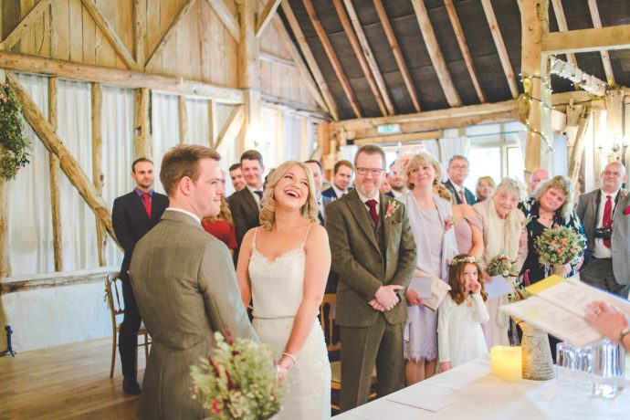 bride-and-groom-say-wedding-vows-clock-barn-wedding-venues-hampshire